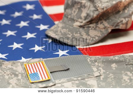 Usa Flag With Us Military Uniform Over It - Studio Shot