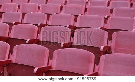Red Empty Chairs In The Stadium