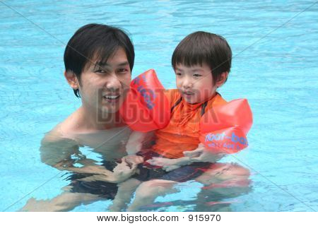 Man And Boy In The Pool