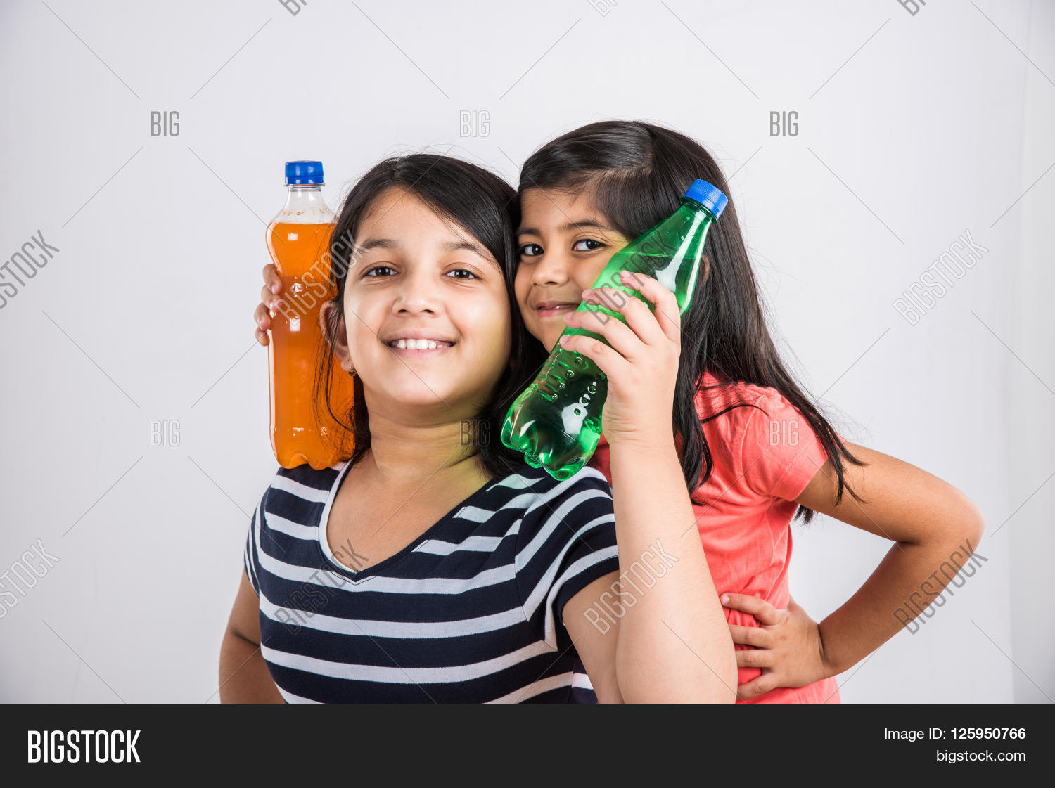Two Indian Girls With Cold Drink Bottle Asian Posing In Pet 2 Girl Kid And Cute Playing