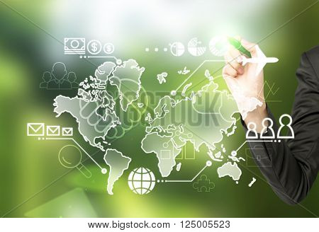 Hand touching virtual map drawn on blackboard money people and communication points and plane on it. Concept of business logistics.