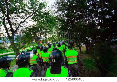 Quito, Ecuador - April 7, 2016: Police leaving marching peaceful anti tax march in Shyris Avenue with anti Rafael Correa goverment protestors.