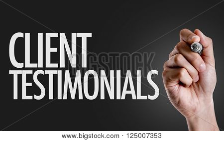 Hand writing the text: Client Testimonials