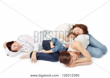 Women of all ages are sleeping on the floor on a white background in white shirts and jeans, studio isolated