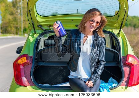 Stylish Beautiful Girl On The Sidelines Of Road Resting