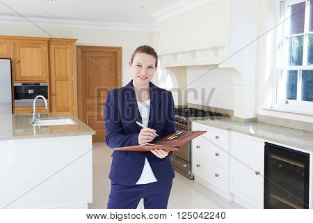 Female Realtor Looking Around Vacant New Property
