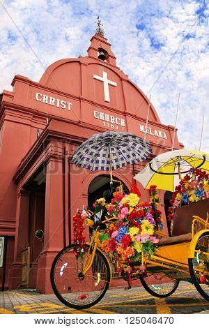 Two icons of Malacca Malaysia : The trishaw or beca and Christ Church
