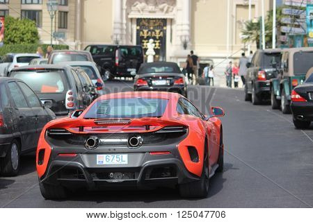 Monte-Carlo Monaco - April 6 2016: Red McLaren 675LT Supercar in the Streets of Monaco in Front of The Monte-Carlo