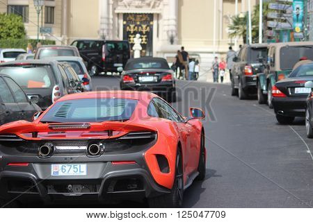 Monte-Carlo Monaco - April 6 2016: Red McLaren 675LT Supercar in the Streets of Monaco in Front of The Monte-Carlo Casino