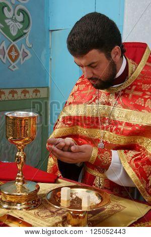 LUTSK UKRAINE - NOVEMBER 02 - Priest consecrates bread during orthodox liturgy ceremony in Lutsk on November 02 2008.
