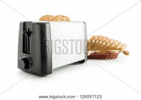 Electric toaster arranged with wholemeal toast bread slices placed on a cotton cloth napkin in a wicker basket isolated on white background.