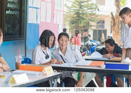 LOEI, THAILAND-MARCH 20, 2016 : Unidentified Asian mother took her daughter and son to enroll in secondary schools of Thailand on MARCH 20, 2016.