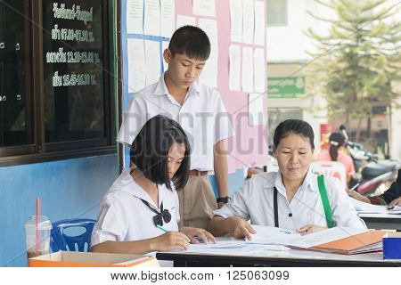 LOEI THAILAND-MARCH 20 2016 : Unidentified Asian mother took her daughter and son to enroll in secondary schools of Thailand on MARCH 20 2016.