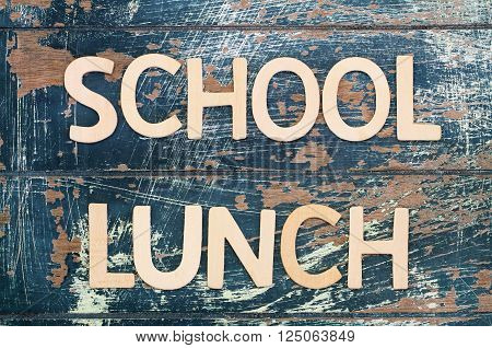 School lunch written with wooden surface on rustic surface