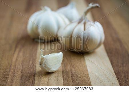 Organic garlic on wood background.vegetable raw food