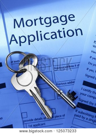 Mortgage Application with house keys on a blue background