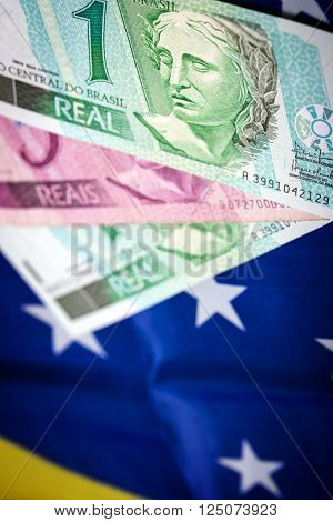 different rasil bank notes on a brasilian flag