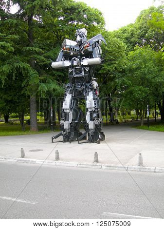 PODGORICA MONTENEGRO-May 15: Transformer sculpture art made of automobile parts is seen at exhibitTransformers defending Podgorica in park Montenegro on May 15 2015.
