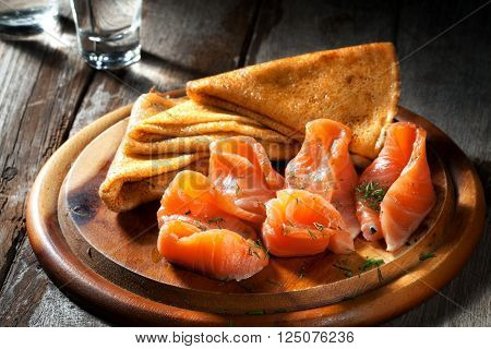 view of nice fresh hot crepes with smoked salmon  on color background