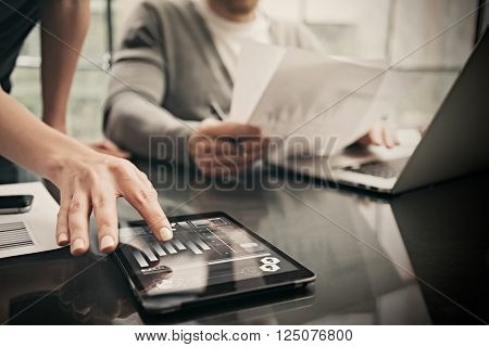 Finance department working process.Picture woman showing business reports modern tablet, diagram screen. Banker manager holding pen for signs documents, discussion startup idea.Horizontal.