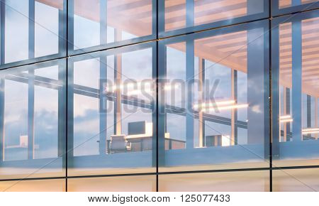 Closeup photo of modern business center.High floor office, interior in evening time. Panoramic windows facade background, contemporary building. Empty meeting room.Horizontal, flares. 3D rendering
