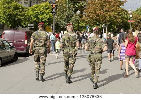Paris France-August 13 2013: soldiers patrol in Paris against the risk of terrorist attack