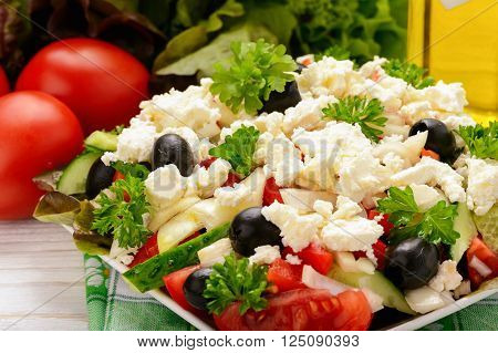Vegetable salad with tomatoes, cucumbers, oilves and feta cheese -bulgarian traditional summer salad.