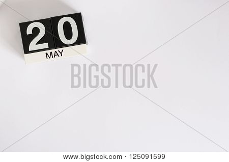 May 20th. Image of may 20 wooden color calendar on white background.  Spring day, empty space for text. World Metrology Day.
