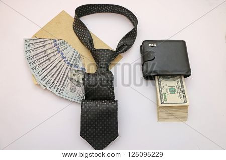 composition of objects as a purse full of bills an envelope filled with cash tie semiautomatic weapons.