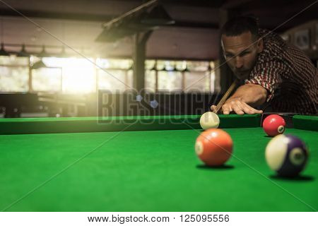 Man plays billiard or snooker. Free space for your text.