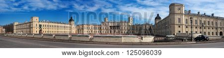 Gatchina Palace. Panoramic shot of the Palace Square and the main entrance. Outside the castle a memorial to Paul 1.