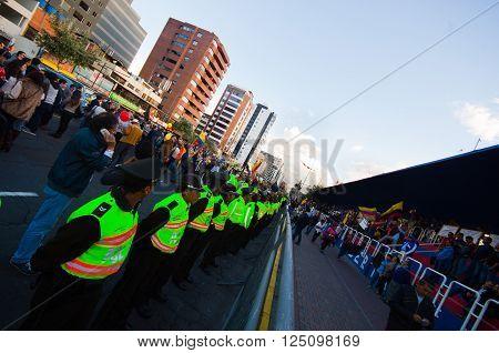 Quito, Ecuador - April 7, 2016: Police awaiting overlooking peaceful anti tax march in Shyris Avenue. Anti Rafael Correa goverment protestors.