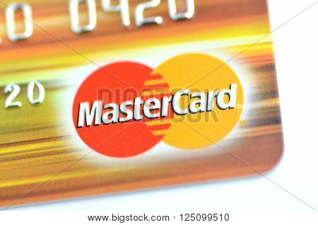 GDANSK, POLAND - JANUARY 18, 2016: Closeup of MasterCard debit card isolated on white background. MasterCard Incorporated is American multinational financial services corporation. It was founded in 1966.