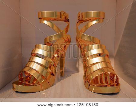 Gold high heels on shelves of shop closeup