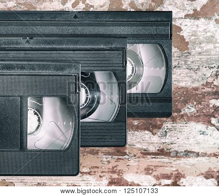 three videocassette close up on a wooden surface retro-style old record sound and images