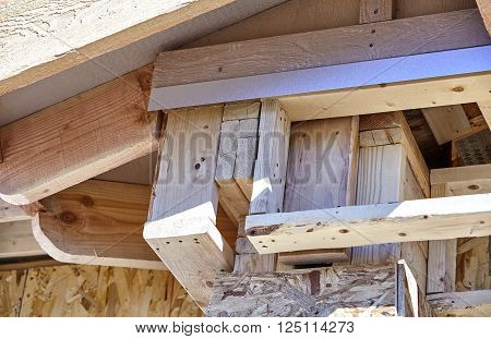 Home Building Construction Carpentry corner post roof eave framing closeup