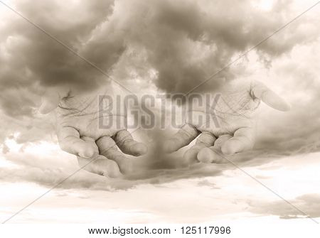 Human open empty hand with sky background. - concept. the hand of God to assist all people to be free from suffering.