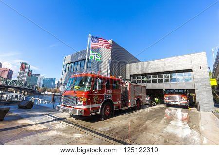 portland,usa:fire trucks stop in fire station in portland in Nov,12,2015