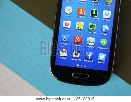 BOISE, ID - MARCH 23, 2015: A Samsung Galaxy touch screen smart phone with various apps showing in the home page. Social apps are very popular with people ranging in age from kids to grandparents