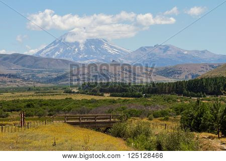 A bridge and volcano Lanin at bottom in Patagonia horizontal picture