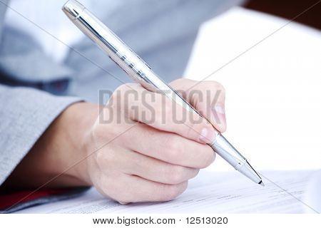 woman write by pen