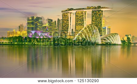 Singapore - CIRCA MAY 2015: Marina Bay skyline and view of Marina Bay Sands at twilight. The Marina Bay is a bay near Central Area in of Singapore and lies to the east of the Downtown Core.