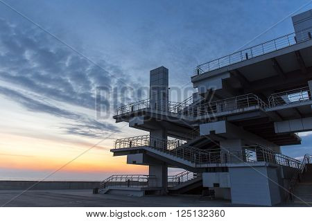 Modern architechture building on sea sunset sky background