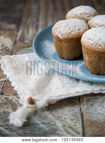 Freshly baked homemade muffins with powdered sugar