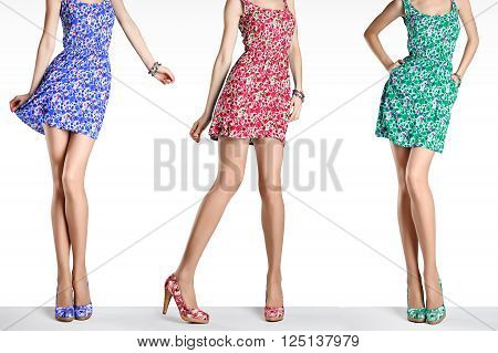 Woman in fashion vintage dress and high heels. Female sexy long legs, stylish colorful flower sundress and summer shoes. Girl in various playful poses. Unusual creative walking out outfit, people