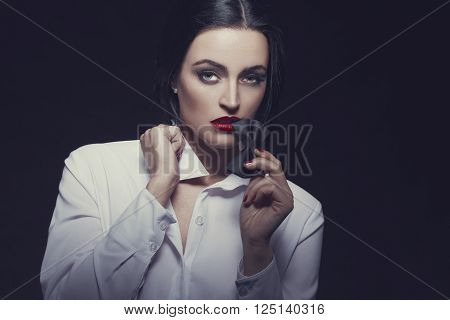 Sensual woman bite tux at night desire retro style
