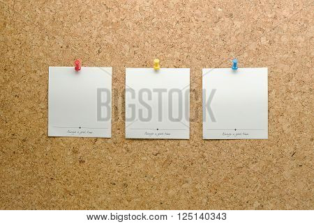 Paper cards posted on a cork board with tack pin