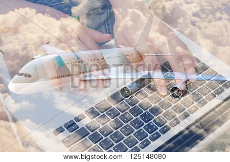 Double Exposure Of Businessman Use Computer Notebook With Airplane And Cloud Sky