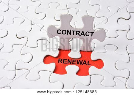 CONTRACT RENEWAL with missing puzzle on red background