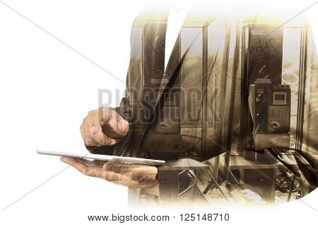 Double Exposure Of Businessman Use Computer Tablet With Phone Booth